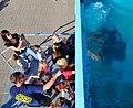US Navy 100906-N-4128S-009 Navy Diver 1st Class Cory Clifton helps children play Tic-Tac-Toe.jpg