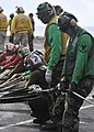 US Navy 101018-N-7103C-067 Sailors pull the upper load strap of a barricade net into place during a barricade drill aboard the aircraft carrier USS.jpg