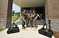 US Navy 110604-N-YO394-114 Officers cut a ribbon opening the new command building for Explosive Ordnance Disposal Operational Support Unit 10.jpg