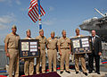 US Navy 110805-N-VK779-121 Senior leaders stand in unison during a ceremony highlighting the March 19 combat launch of the 2,000th Tomahawk land-at.jpg