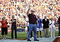 US Navy 111007-N-XX999-001 Lt. Cmdr. Josh Feldman waves to the crowd at Lane Stadium during a halftime ceremony at the VT and University of Miami f.jpg