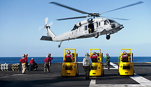 US Navy 120212-N-OY799-450 Aviation Ordnancemen observe an MH-60S Sea Hawk helicopter from the Eightballers of Helicopter Sea Combat Squadron (HSC).jpg