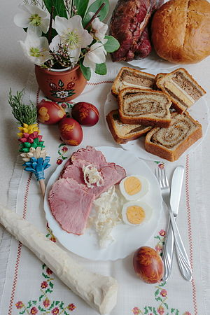 Traditionaln easter breakfast with eggs, ham, and [en:nut roll