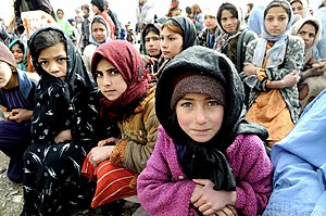 GOZARAH, Afghanistan-Village girls wait as the...