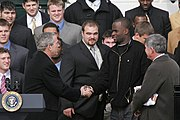 Young at the White House with George W. Bush, Mack Brown, and members of the 2005 national championship team.