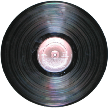 Most LPs were pressed in black vinyl with a paper label in the center of each side. However, colored and picture discs were also made