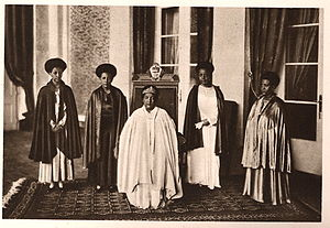 Princess Tenagnework - Empress Menen Asfaw seated in the centre and Standing women from left to right are Princess Tsehai, Princess Tenagnework, and Princess Zenebework, her daughters, and on the far right is Princess Wolete Israel Seyoum, her daughter-in-law.