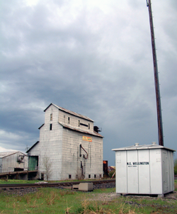 The grain elevator and railroad.