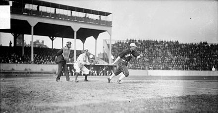 Fielder Jones of the White Sox hits the ball against Cubs at West Side Grounds, 1905 West Side Grounds 1905.jpg