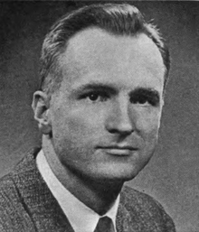 A black-and-white photo of Hudnut dressed in a suit