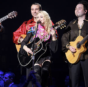 "Evita (soundtrack) - Madonna performing the lead single, ""You Must Love Me"", on the Sticky & Sweet Tour (2008–09). It went on to win the Academy Award for Best Original Song."