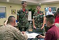 Young Marines Cpl. Joseph DiGiovanni and Young Marines Sgt. Maj. Storme DiGiovanni chat with prospective parents.jpg