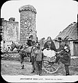 'Irish life' paying 'for the jaunt'. One woman and four men, with various hats. (25600626781).jpg