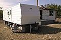 (Hurricane Katrina) Diamond, LA, 11-11-05 -- FEMA Contractor Travel Trailer Inspector Mike Miller checks the trailer blocking to his specifications sheet. Travel Trailers are one of - DPLA - 4e7659f5dd5f7c1c66bdd71fcf3b7bd5.jpg