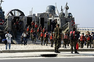 Mexican response to Hurricane Katrina - Mexican sailors assigned to the Mexican amphibious ship ARM Papaloapan (P-411) debark a U.S. Navy Landing Craft Air Cushion (LCAC) as they prepare to work on rehabilitation projects in the Biloxi, MS area.