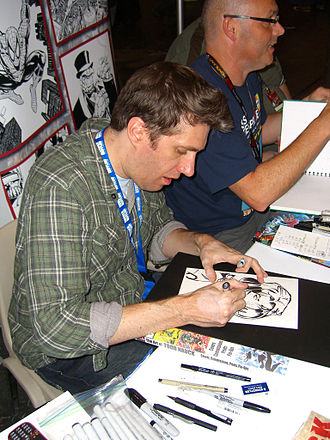 Todd Nauck - Nauck doing a Donna Troy sketch at the 2011 New York Comic Con. Beside him is Andy Lanning.