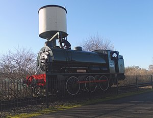 Hunslet Austerity 0-6-0ST - Hunslet 0-6-0ST Austerity WD75008 takes on water from the water tower at Peterborough Nene Valley on the Nene Valley Railway