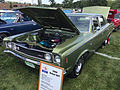 1969 AMC Rebel SST 4-door sedan in green at 2015 AMO show 2of6.jpg