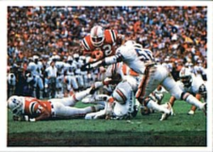 1985–86 NFL playoffs - Craig James rushes the ball past the Dolphins' defense in the AFC Championship game.