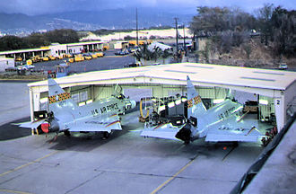 Hickam Air Force Base - Hawaii ANG 199th Fighter Interceptor Squadron F-102s in maintenance hangar at Hickam, 1976 Convair F-102A-30-CO Delta Dagger 54-1373 identifiable, aircraft now on static display at Hickam.