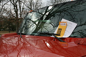 English: A red Hummer with a parking ticket at...