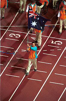 201000 - Opening Ceremony swimmer Brendan Burkett flag 3 - 3b - 2000 Sydney opening ceremony photo.jpg