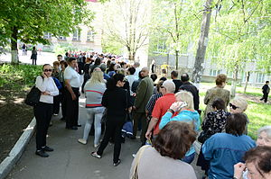 Self-determination - Donetsk status referendum organized by separatists in Ukraine. A line to enter a polling place, 11 May 2014