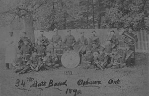 Oshawa Civic Band - A photograph of the 34th Battalion military band, with instruments, taken in 1892.