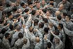 374th Security Forces Squadron join in a group huddle.jpg