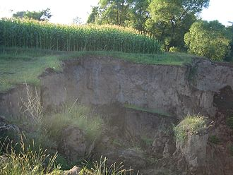 Loess Plateau - Erosion gradually deprives a corn farmer of his land in Linxia City, Gansu
