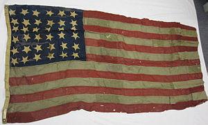 63-318-A Flag, US, USS OLYMPIA.jpg