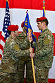 720th STG CC passes guidon to 26th STS CC.jpg