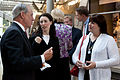 A. Raymond Randolph, left, a federal judge on the U.S. Court of Appeals for Washington, D.C. and the Sunset Parade guest of honor, speaks with guests during the parade reception at the Women in Military Service 130604-M-MM982-007.jpg