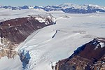 A Glacier Flows Through a Section of the McMurdo Dry Valleys in Antarctica (30913580055).jpg