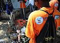A Haitian sanitation crew works to keep a temporary living area clean Feb. 22, 2010, in Petionville, Haiti 100222-N-HX866-010.jpg