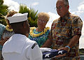 A U.S. Sailor, left, presents a U.S. flag to the son of retired Chief Petty Officer Earl Selover after a ceremony at the USS Utah Memorial on Ford Island in Pearl Harbor, Hawaii, May 22, 2013 130522-N-QG393-123.jpg