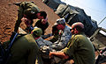 A U.S. Soldier with simulated wounds is treated by U.S. Army and Israel Defense Forces medics during a medical exercise for Austere Challenge 2012 in Beit Ezra, Israel 121022-F-QW942-079.jpg