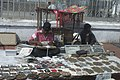 A coin vendor at Charminar market, in Hyderabad on January 9, 2006.jpg