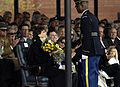 A member of the U.S. Army Honor Guard presents flowers to Sheila Casey, 2007.jpg