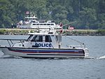 A small white police boat patrols Toronto's harbour, on Canada Day, 2016 (19) (27419887384).jpg