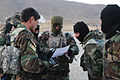 Afghan National Army commandos and Afghan National Army Special Forces go over their mission plan one last time before Mi-17 helicopters assigned to the Special Missions Wing come to get them in Kabul province 131224-A-CL980-259.jpg