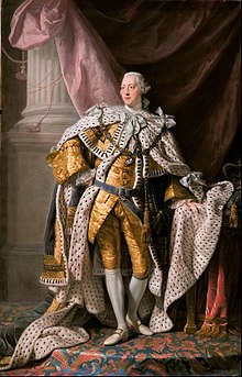 Full-length portrait in oils of a clean-shaven young George in eighteenth century dress: gold jacket and breeches, ermine cloak, powdered wig, white stockings, and buckled shoes.