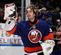 Al Montoyo skating with the Islanders with his goaltender mask off.