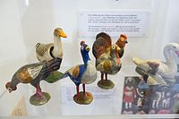 Antique toy chickens and ducks (26431134836).jpg