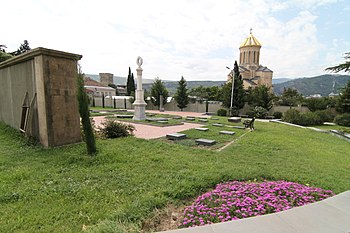 Armenian Pantheon of Tbilisi with Sameba Cathedral.JPG