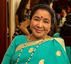 A woman wearing White saree.