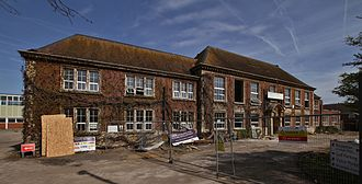 Ashford, Surrey - The former Ashford County Grammar School after Inland Homes plc tried to demolish it