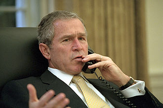 Foreign policy of the George W. Bush administration - Bush talks with South Korean President days after the 9/11 attacks.