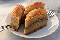Baklava is prepared on large trays and cut into a variety of shapes