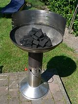 Briquettes placed in a barbecue cooker